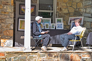 Julia Flanagan photographs displayed on the front porch of the Stone House Visitor Center lawn