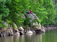 Youth Perch on Rocks Along the Occoquan Reservoir Shoreline